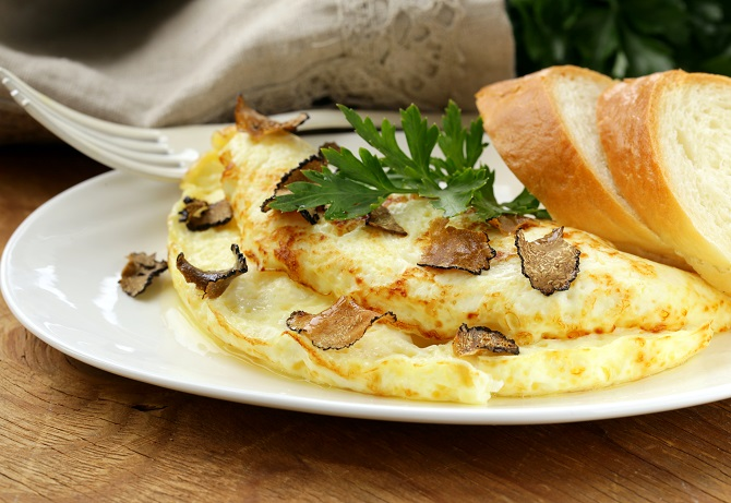 Gourmet omelette with black truffle and herbs